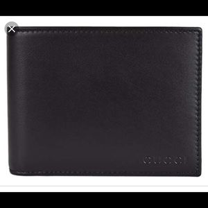 a5727e84a472 Gucci Men's Leather Logo Embossed Wallet